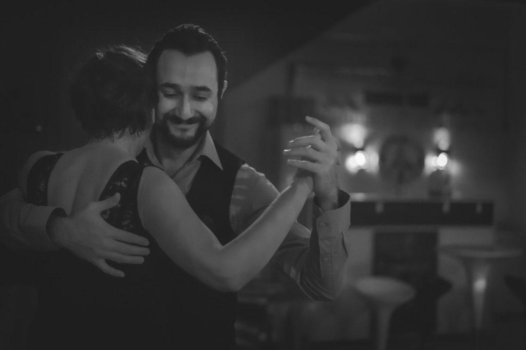Couple dancing indoors.